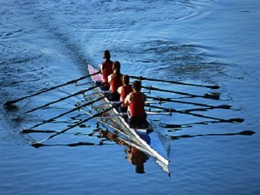 ca. 2001 --- Rowers Rowing Boat --- Image by © Royalty-Free/Corbis